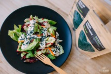 Salad with creamy topping and spirulina